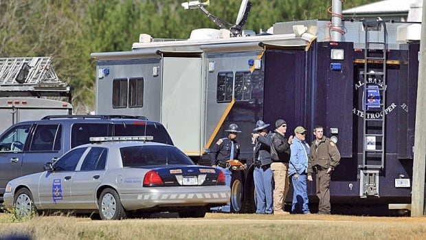 Law officers have been negotiating for three days with an armed man suspected of killing a school bus driver and taking a five-year-old boy hostage in Midland City, Ala.