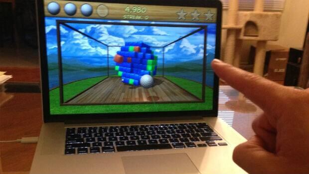 Peter Nowak's finger directs the Leap Motion controller on his home laptop. Very promising technology, but will it be fulfilled.