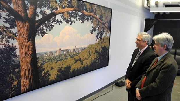 Artist E. Robert Ross (right) and Mohawk College president Rob MacIsaac with Ross's painting, View of Hamilton.