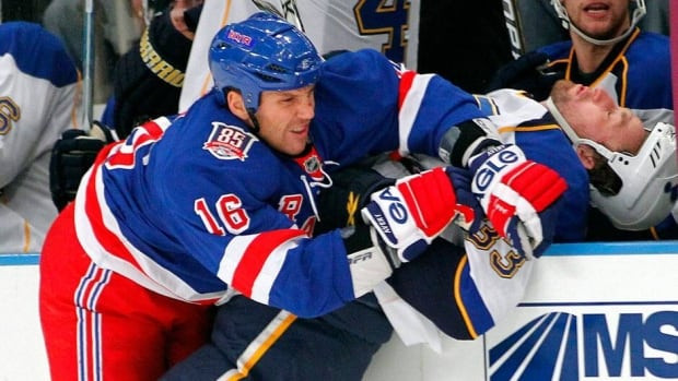 Sean Avery, left, sent out a tweet on Saturday night that seemed to imply he was calling for the firing of a certain NHL head coach.