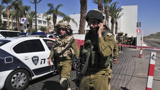 Israeli soldiers secure the area near the site of a shooting incident at a hotel in the Red Sea resort town of Eilat on Friday. A young American opened fire in the hotel, killing one person before police shot him dead in what appeared to be a personal dispute. (AP Photo/Eliraz Getah) ISRAEL OUT