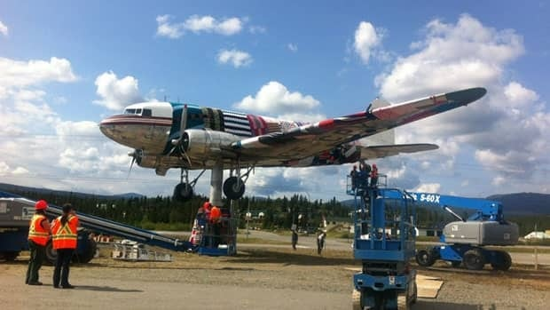 Knitters in Whitehorse covered a Second World War-era airplane that sits on a platform outside the Yukon Transportation Museum in yarn on Saturday.
