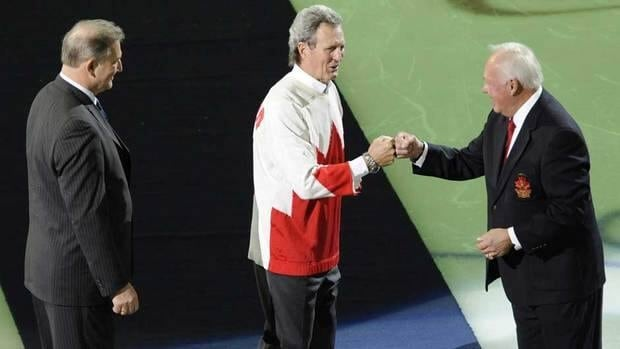 Summit Series stars Paul Henderson, centre, Vladislav Tretiak, left, and Yvan Cournoyer, reunite for a ceremonnial puck drop Jan. 7 in Montreal. Henderson has reportedly agreed to participate in a 40th anniversary game on Feb. 26 in Moscow.
