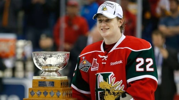 Halifax Mooseheads Nathan MacKinnon stands with the Stafford Smythe Memorial Trophy after being named tournament MVP after the Memorial Cup final in Saskatoon, Sask., on Sunday.