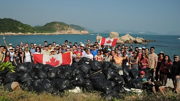 A group of volunteers called Team Canada display some of the garbage they picked up during last year's annual Hong Kong Cleanup competition, a community event that attracts nearly 40,000 people.