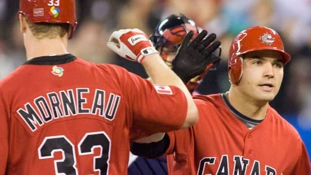 Joey Votto, right, and Justin Morneau give Canada a potent 1-2 punch in the middle of the batting order at the World Baseball Classic. The Canadians begin play Friday against Italy at 2:30 p.m. ET in Phoenix.