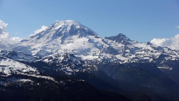 Mount Rainier in June, as seen from a helicopter south of the mountain and west of Yakima, Wash. Three Canadian climbers were injured while attempting to summit the mountain over the long weekend. They were reportedly on the Emmons Glacier route.