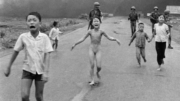 In this June 8, 1972 file photo, crying children, including 9-year-old Kim Phuc, centre, run down a road near Trang Bang, Vietnam after an aerial napalm attack.