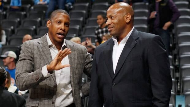 Denver Nuggets general manager Masai Ujiri, left, talks with New Orleans Hornets general manager Dell Demps before a 2012-13 game.