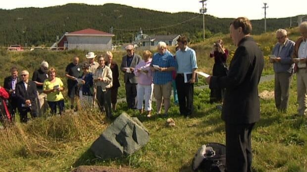 Residents in Portugal Cove gathered for a reburial ceremony on Wednesday to put bones displaced by new housing development back in the ground.