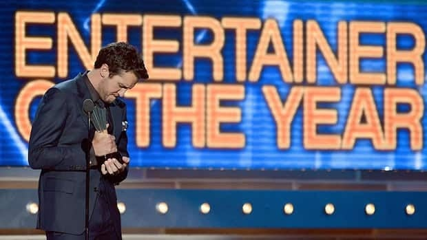 Recording artist and Academy of Country Music Awards co-host Luke Bryan reacts as he accepts the ceremony's entertainer of the year award at the MGM Grand Garden Arena in Las Vegas on Sunday.