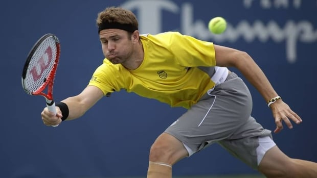 Mardy Fish stretches to return a shot against Jarkko Nieminen on August 20, 2013 in Winston Salem, North Carolina.