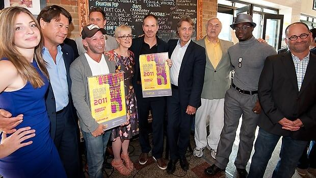 The Barney's Version team and Telefilm Canada executive director Carolle Brabant, fifth from left, celebrate the film's win of the Golden Box Office Award on Thursday at a Toronto deli.