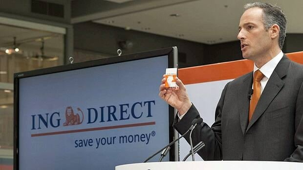 ING Direct CEO Peter Aceto holds one of the company's debit cards at the service's launch in 2010. The company's Dutch parent said earlier this month it was considering selling the Canadian unit.