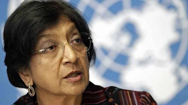 U.N. High Commissioner for Human Rights Navi Pillay addresses a news conference at the United Nations European headquarters in Geneva October 18, 2012. The top United Nations human rights official said the situation in Syria was reminiscent of Bosnia's sectarian war and called on world powers on Thursday to unite in trying to halt the bloodshed. Pillay, a former U.N. war crimes judge, said both sides in the Syrian conflict may have committed war crimes or crimes against humanity.