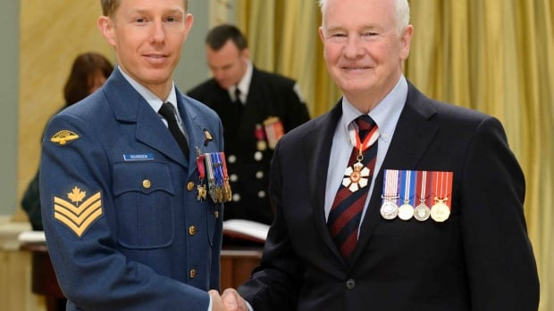 Sgt. Robin Richardson receives a Star of Courage from Governor General David Johnston in Ottawa Friday.