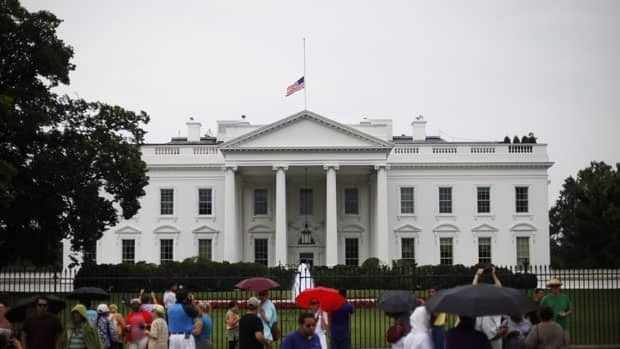 The American flag flew at half-staff over the White House in the wake of the tragic mass shooting in Aurora, Colo. U.S. President Barack Obama and Republican opponent Mitt Romney temporarily silenced their presidential campaigns out of respect for the victims.