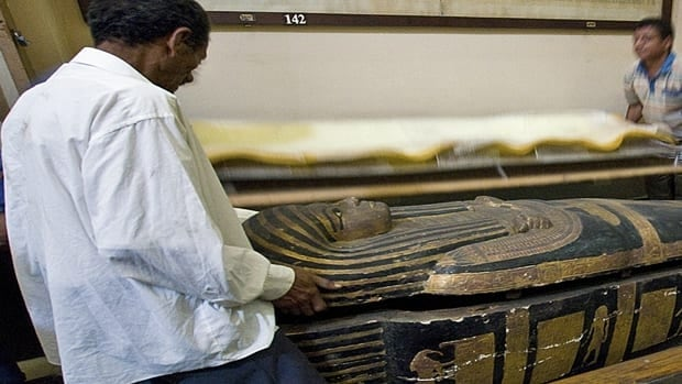 A group of cardiologists show the sarcophagus of the mummy Hatiay as it was closed after a CT scan in Cairo. The study showed people probably had clogged arteries and heart disease some 4,000 years ago.