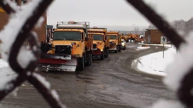 Striking Metro Transit workers in Halifax slowed snow plows from leaving the lot in Burnside.