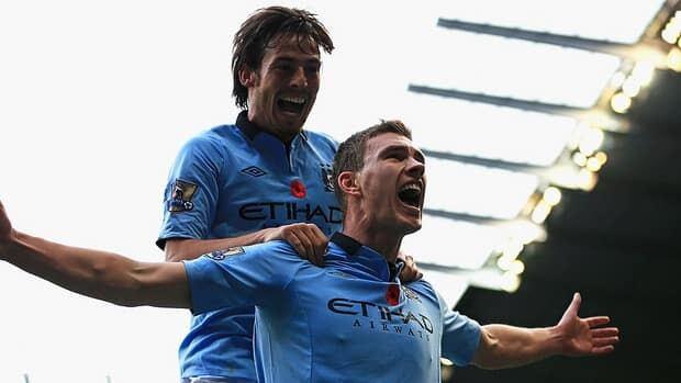 Edin Dzeko of Manchester City, right, celebrates with David Silva after scoring against Tottenham at the Etihad Stadium on November 11, 2012.