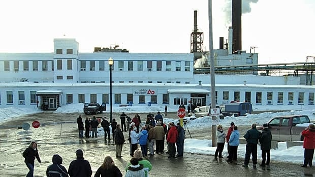 A crowd gathers outside the AbitibiBowater paper mill in Grand Falls-Windsor, after the company shut down production on Feb. 12, 2009.