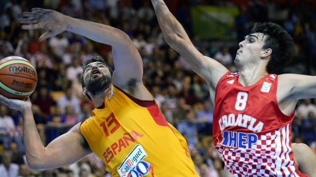 Marc Gasol of Spain, left, vies with Dario Saric of Croatia during the game in Celje on September 4, 2013.