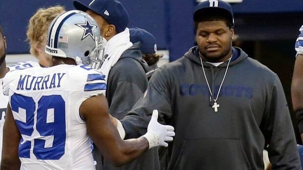 Dallas Cowboys suspended player Josh Brent, right, is greeted by DeMarco Murray on the sideline during the first half of an NFL football game against the Pittsburgh Steelers on Sunday.