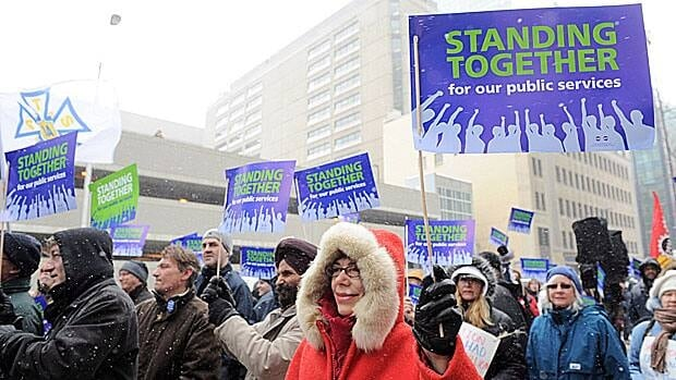Members of the Public Service Alliance of Canada demonstrate outside their offices to support all Canadians who depend on public service in Ottawa on March 1.