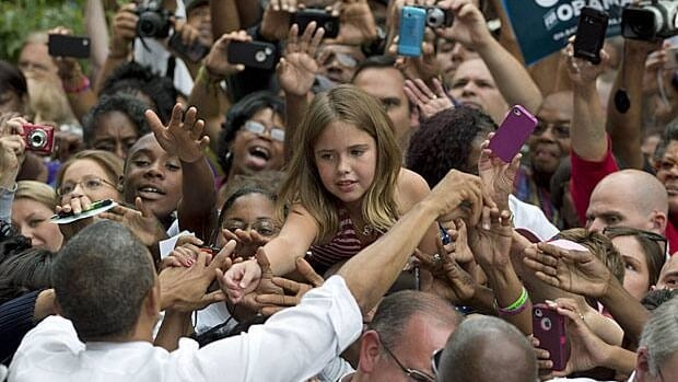 Barack Obama greets supporters at a campaign rally at Cincinnati's Eden Park on Sept. 17.