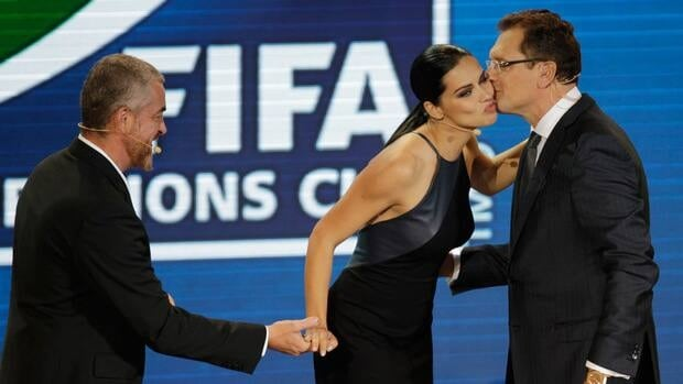 FIFA Secretary General Jerome Valcke, right, welcomes draw assistants Brazilian supermodel Adriana Lima and renowned chef Alex Atala, left, during the draw for the 2013 soccer Confederations Cup in Sao Paulo, Brazil, on Saturday.