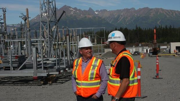 Energy and Mines Minister Bill Bennett and BC Hydro Vice President Greg Reimer at the Northwest Transmission Line Bob Quinn substation during a tour of the Northwest in August 2013. Bennett said Friday that one of the ways that BC Hydro will attempt to cut costs in coming years is to spend less on its contracted-energy supply.