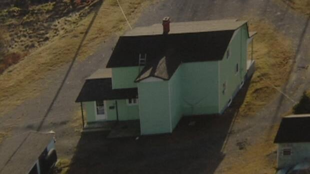 A photo showing the back of the house where the Bay Bulls standoff took place was shown during Leo Crockwell's trial Friday.