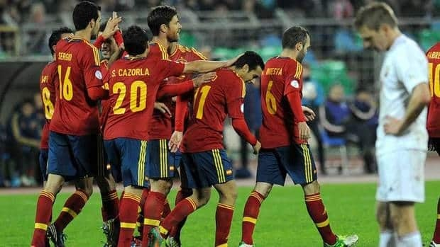 Spain celebrates during the FIFA 2014 World Cup qualifying match against Belarus at the Dinamo Stadium in Minsk, on October 12, 2012.