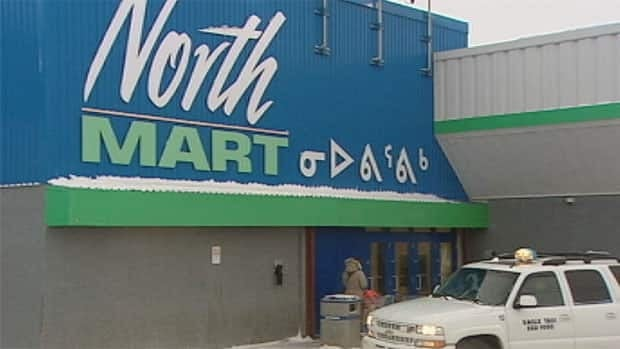 A person enters the NorthMart store in Iqaluit. Preparations are underway for protests in Nunavut on Saturday against high food prices in the territory.