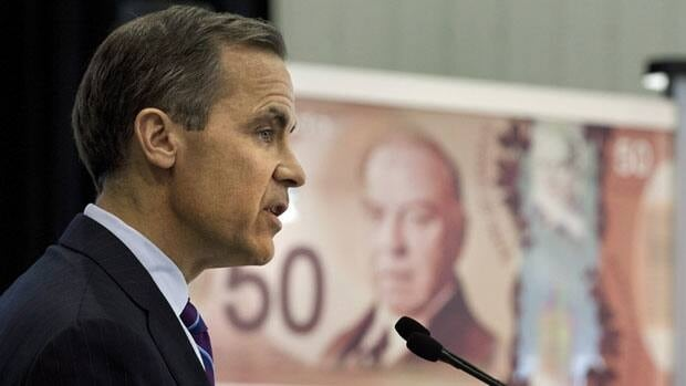 Bank of Canada governor Mark Carney introducing the new $50 bill made of polymer in Quebec City. He said if Canadians continue to pile on the debt, he's willing to use monetary policy tools to combat the rise and prevent a crisis.