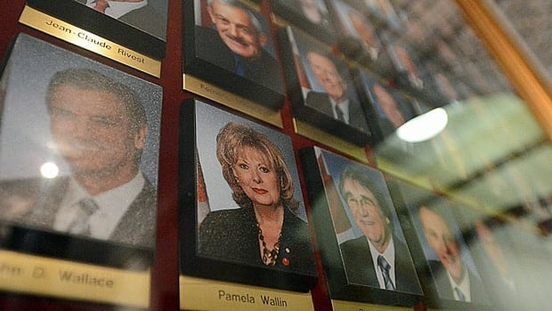 A photograph of Senator Pamela Wallin is displayed alongside photographs of her fellow Senators in the Centre Block of Parliament Hill. The federal auditor general will soon be taking a closer look at senators' expenses.