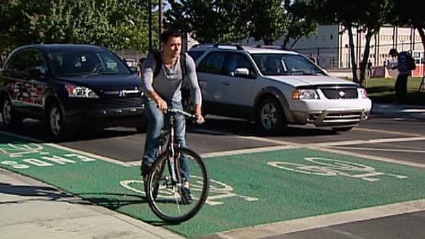 The city unveiled its first 'bike box' at 116th Street and 87th Avenue Thursday.