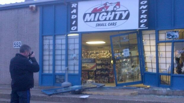 Police believe a vehicle was used to smash in the front door and window at Mighty Small Cars.