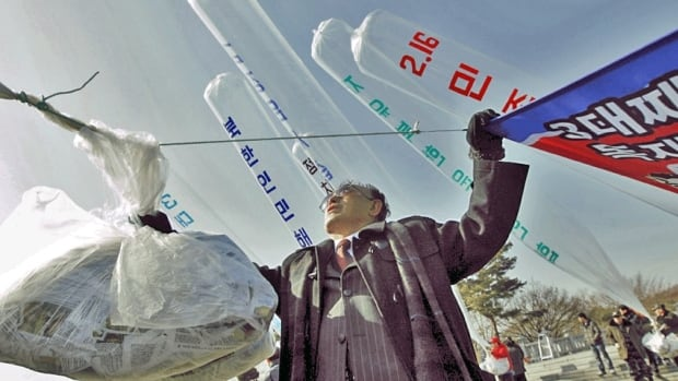 An anti-North Korean activist prepares to release balloons containing leaflets and CDs denouncing Pyongyang towards North Korea.
