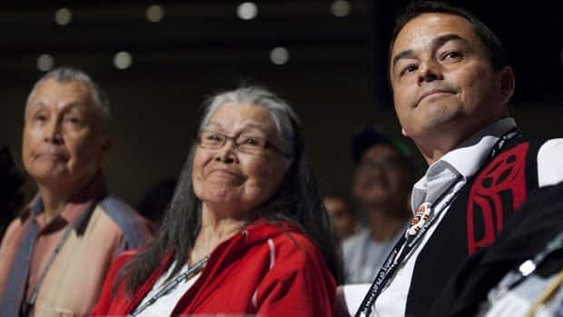 Shawn Atleo, seen at right with his aunt Flossie Atleo, needed three rounds of voting on Wednesday to secure his re-election as national chief of the Assembly of First Nations.