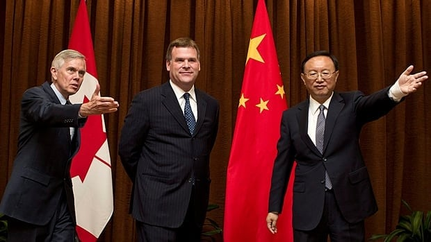 Canada's ambassador to China, David Mulroney, guides Foreign Affairs Minister John Baird during a visit to the Chinese Foreign Ministry and meetings with Baird's Chinese counterpart, Yang Jiechi, last summer. Mulroney believes China is moving away from its doctrine of non-interference in international conflicts, which could help end the crisis in Syria.