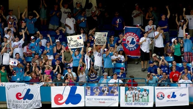 Montreal Expos fans fill an outfield section at the Rogers Centre during a game between the Toronto Blue Jays and the Tampa Bay Rays in Toronto on Saturday. The Montreal fans hope to lure a major league team back to their city.