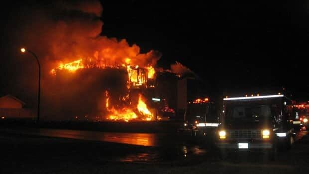 Fire crews battling the apartment blaze in Ste. Anne, Man., late Monday night.