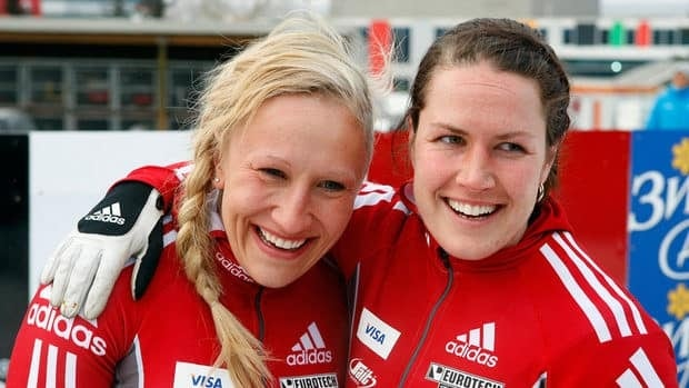 Kaillie Humphries, left, and her brakeman Jennifer Ciochetti, celebrate their win following the women's World Cup bobsleigh event in Calgary.