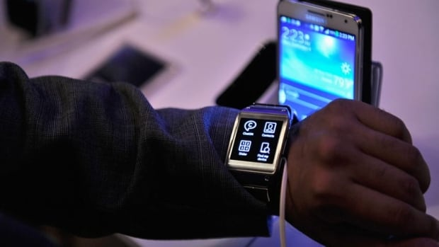 Samsung's Galaxy Gear 'smart' wristwatch links up with the company's latest smartphone and tablet computer to make phone calls, shoot video, run apps signal incoming messages.
