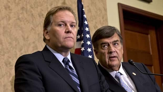 House Intelligence Committee Chairman Rep. Mike Rogers, left, and the committee's ranking Democrat, Rep. C.A. Dutch Ruppersberger, speak to reporters Monday after releasing a report on a yearlong probe of China's two leading technology firms, Huawei Technologies Ltd. and ZTE Corp.