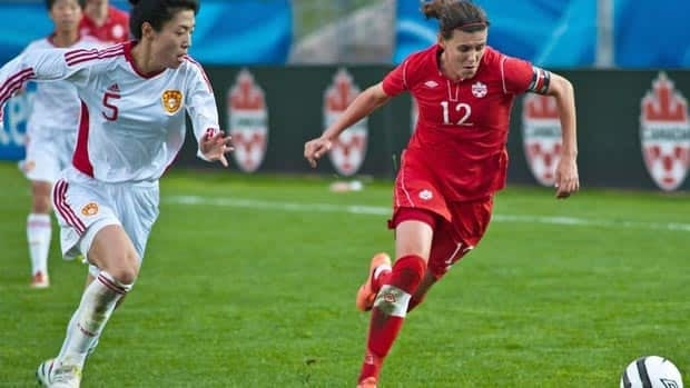 Canada's Christine Sinclair tries to out run a Chinese player during a soccer match in Moncton in May.  A new report says the Maritimes could support a pro sports team.