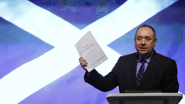 Scotland First Minister Alex Salmond holds a copy of the agreement on a referendum of independence for Scotland, during a news conference at St Andrew's House in Edinburgh on Monday.