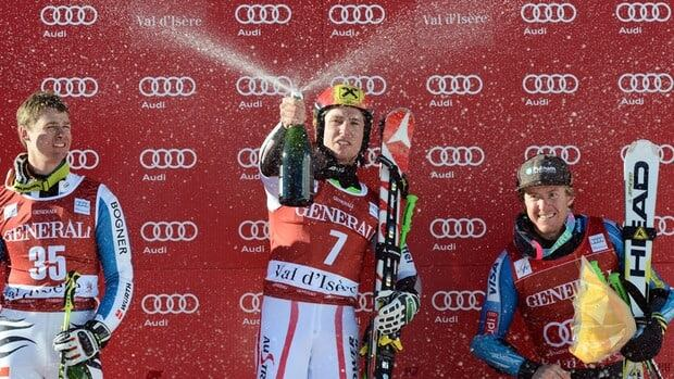 Marcel Hirscher of Austria, centre, celebrates on the podium next to Ted Ligety of the U.S., right, and Stephan Luitz of Germany.