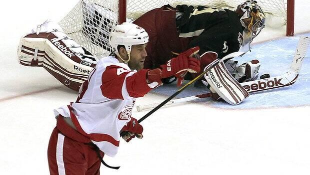 Detroit Red Wings' Todd Bertuzzi, left, has re-signed with the team. Bertuzzi was first acquired by the Red Wings in 2007 as part of a trade deadline deal with the Florida Panthers.